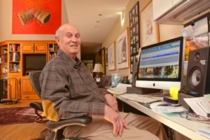 Ralph Lowen sits at his work station at his home in Amherst, Wednesday. He records audio histories.